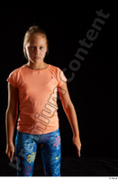 Esme  1 arm dressed flexing front view sports t shirt 0001.jpg